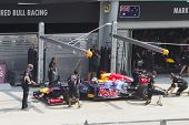 Sebastian Vettel does a trial pit stop