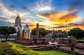Buddha Statue At Sunset Are Buddhist Temple And Major Tourist Attractions At Wat Phra Si Rattana Mah poster