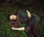 girl lying in forest