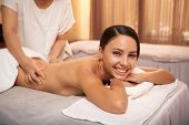 Portrait Of Asian Beautiful Woman Lying On Massage Table And Smiling At Camera While Massage Therapi poster