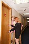 Couple entering hotel room