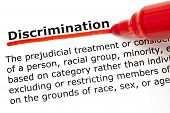 picture of racial discrimination  - Definition of the word Discrimination underlined with red marker on white paper - JPG
