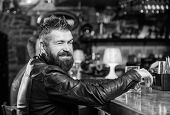 Hipster Relaxing At Bar With Beer. Brutal Hipster Bearded Man Sit At Bar Counter Drink Beer. Order A poster