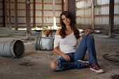 Beautiful Brunette Sitting In An Abandoned Warehouse (2)