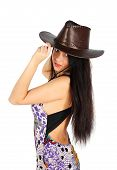 Beautiful Girl Wearing Dress And Leather Hat Stands Isolated On White Background
