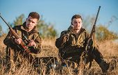 Rest For Real Men Concept. Hunters With Rifles Relaxing In Nature Environment. Hunting With Friends  poster