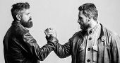 Strong Handshake. Friendship Of Brutal Guys. Leadership Concept. True Friendship Of Mature Friends.  poster