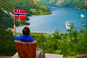 Tourism Vacation And Travel. Female Tourist Enjoying Beautiful View Over Magical Geirangerfjord From poster