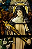 picture of the lost sheep  - Stained Glass window of St Monica holding the cross of Jesus Christ in peaceful prayer - JPG
