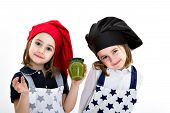 stock photo of zygote  - twins cook with pesto genovese typical recipe of Genoa - JPG