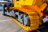 Image Of A Large New Yellow Bulldozer. Fragment Of A Caterpillar Bulldozer.powerful Construction Mac poster