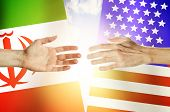 Two Hands Stretch Towards Each Other Against The Background. Hands People Against The Backdrop Flags poster