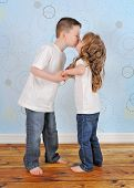 Adorable Young Brother And Sister Sharing A Kiss