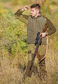 Man Brutal Unshaved Gamekeeper Nature Background. Hunting Permit. Bearded Serious Hunter Spend Leisu poster