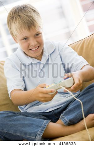 poster of Young Boy In Living Room With Video Game Controller Smiling