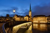 picture of zurich  - Illuminated Fraumunster Church and River Limmat in Zurich Switzerland - JPG