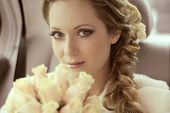 stock photo of hair bow  - Beautiful bride woman portrait with bridal bouquet posing in her wedding day - JPG