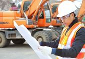 stock photo of heavy equipment operator  - road construction worker and heavy equipment on the background - JPG