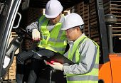 image of forklift driver  - manager talking to forklift driver in a warehouse - JPG