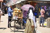 An unidentified street seller sells fresh bread in Zanzibar