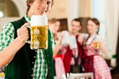 foto of stein  - Young people in traditional Bavarian Tracht in restaurant or pub - JPG
