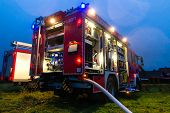 stock photo of ladder truck  - Fire truck or engine with flashing lights - JPG