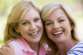 stock photo of close-up middle-aged woman  - Close up of two women smiling - JPG