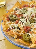 Platter Of Nachos With Salsa Jalapenos And Cheese