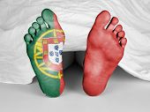 stock photo of unnatural  - Dead body under a white sheet flag of Portugal - JPG
