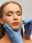 image of scalpels  - picture of woman face and beautician hands with scalpel - JPG