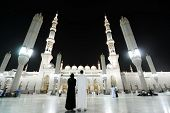 MEDINA - JULY 21 : A couple is standing in the front of holy mosque on July 21, 2012 in Medina, Saud