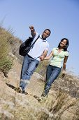 Couples Walking On Path Holding Hands And Smiling