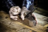 carpenter at work with vintage planer