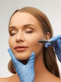 stock photo of scalpels  - picture of woman face and beautician hands with scalpel - JPG