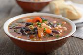 Three bean soup on a rustic table