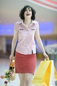 Brunette Girl In Shopping Centre