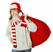 Christmas Old Man With Beard In Red Hat Carrying Santa Claus Bag