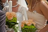 Bridesmaid With Two White Wedding Candles