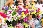 fake flower varicolored in hanging basket