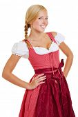 Young attractive bavarian woman in a dirndl with arms akimbo