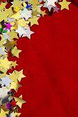 Colorful Stars On Red Velvet Background