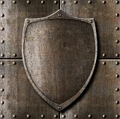 picture of plaque  - old metal shield over armour background with rivets - JPG
