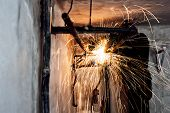 picture of pipe-welding  - Professional welder cutting metallic pipes and grinding steel - JPG