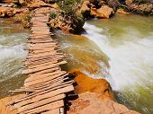 picture of atlas  - Wooden Bridge on Ouzoud River located in the Grand Atlas province of Azilal 150 km northeast of Marrakech Morocco Africa - JPG