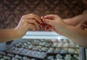 Woman Buying Golden Ring In Jewelry Store