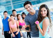 stock photo of sportswear  - Group of people at the gym looking very happy - JPG
