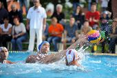 KAPOSVAR, HUNGARY - SEPTEMBER 15: Barnabas Steinmetz (in blue) in action at a Hungarian championship waterpolo game between Kaposvar (white) vs Honved (blue) on September 15, 2013 in Kaposvar, Hungary