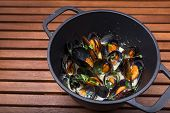 Hot Mussels With Sauce In Coast Iron