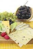 image of grated radish  - Slices of cheese with grapes lettuce and radishes - JPG