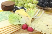 stock photo of grated radish  - Slices of cheese with grapes lettuce radishes and bread - JPG